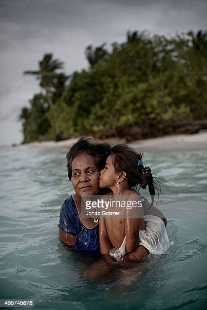 A mother and her daughter taking a dip in the sea Their land is on the northernmost part of the Tarawa atoll which is slowly being consumed by the...