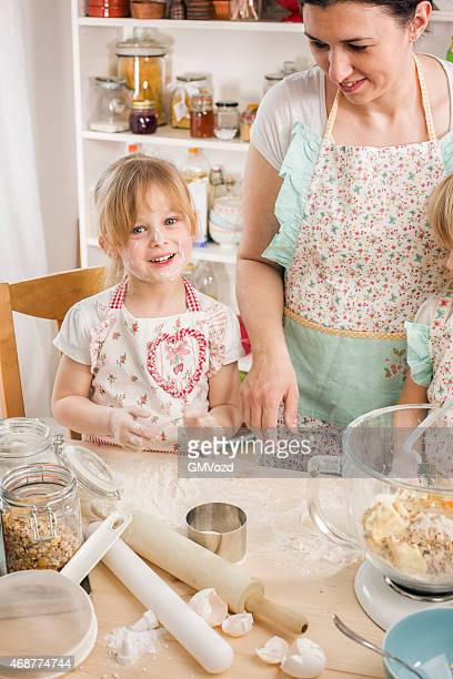 Mother and Her Daughters Preparing Cookies in the Kitchen