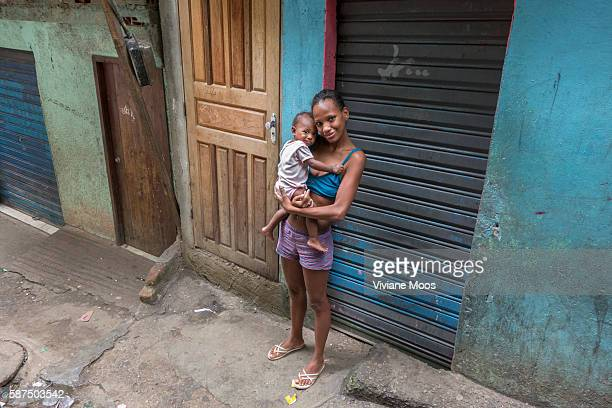 Mother and her little son on a street inside Rocinha the largest Favela or shanty town or urbanized slum in Brazil Today Rocinha is classified as...