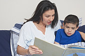 Mother and her son reading a book