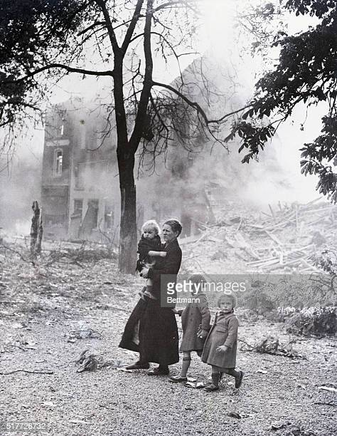A mother and her three children amid the smoking rubble of their city after it had been bombed by the Nazis