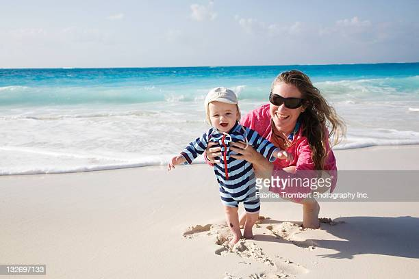 Mother and infant on beach