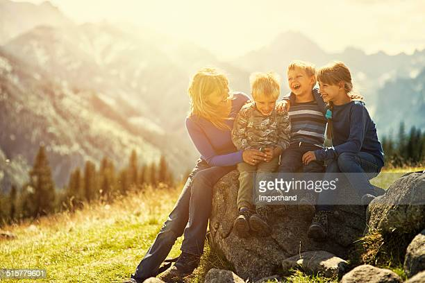 Mother and kids hiking in mountains