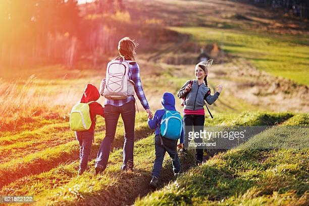 Mother and kids hiking in moutains