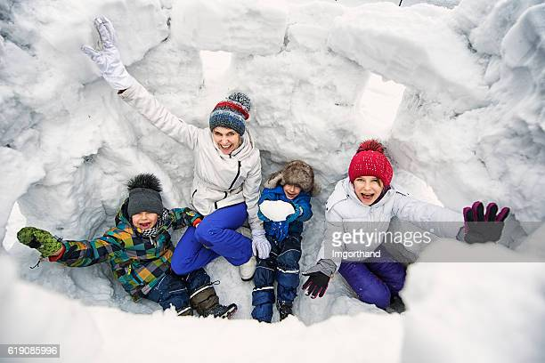 Mother and kids in a snow castle