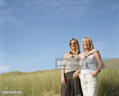 a mother standing tall View stock photo of mother and tall daughter standing backtoback in living room find premium, high-resolution photos at getty images.