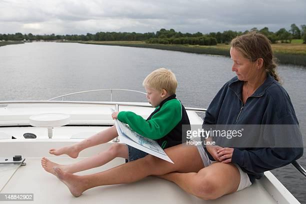 Mother and son aboard Emerald Star Glen Star houseboat, Lough Erne.