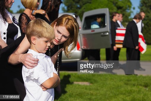 Mother and Son at a Funeral
