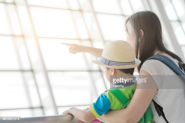 Mother and son at airport waiting for departure
