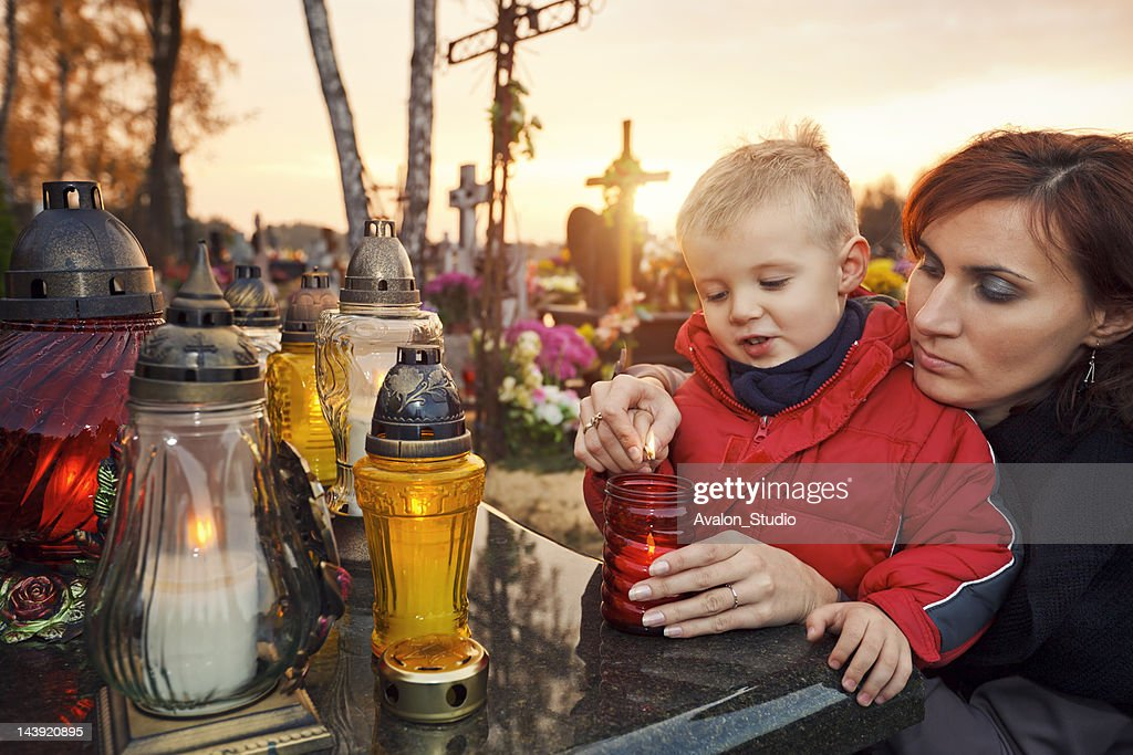 Mother and son at the cemetery : Stock Photo