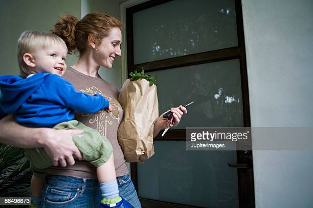 Mother and son beside door