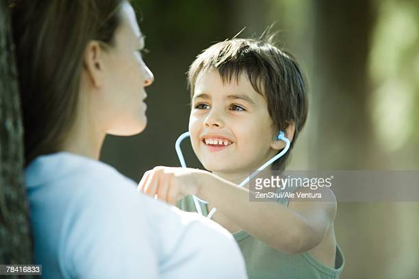 Mother and son, boy pretending to be doctor