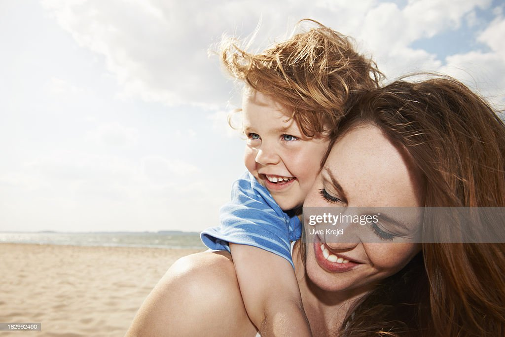 Mother and son by the sea, close up
