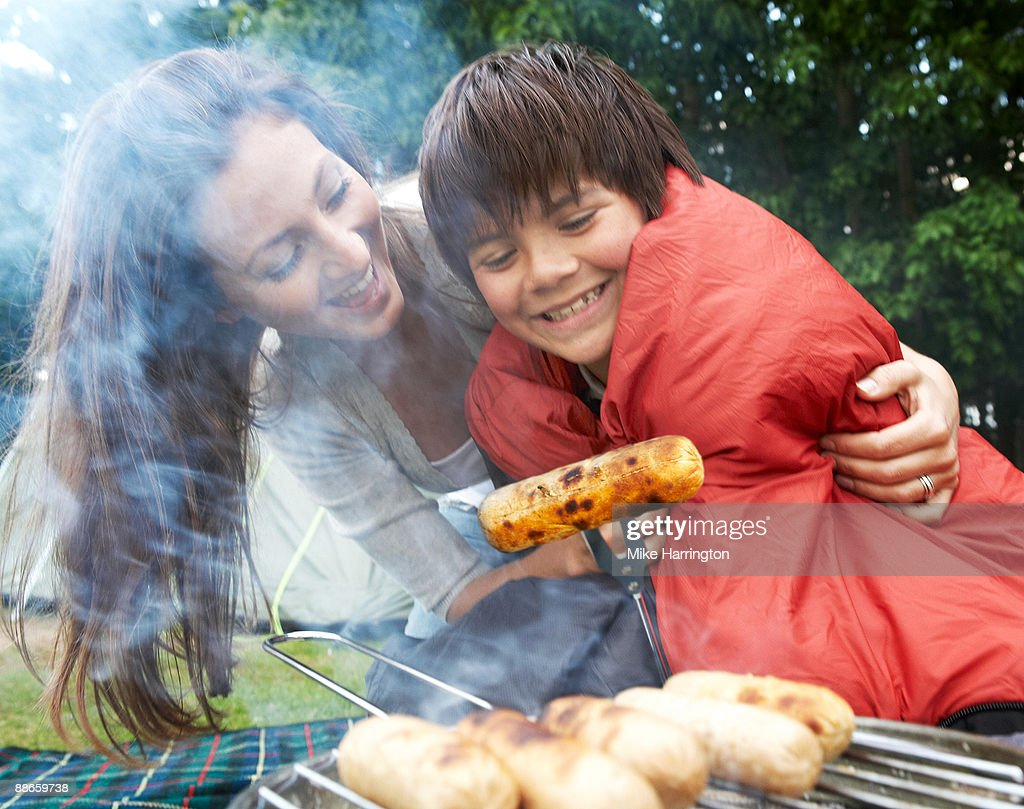 Mother and son camping in forest : Stock Photo