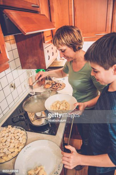 Mother and Son Cooking Home Made Gnocchi, Southern Europe