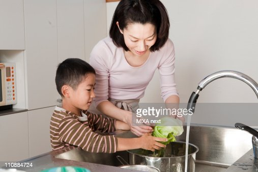 Mother and Son Cooking Together : Stock Photo