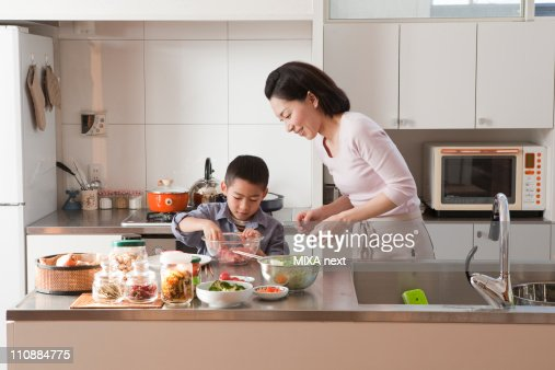 Mother and Son Cooking Together : Foto stock