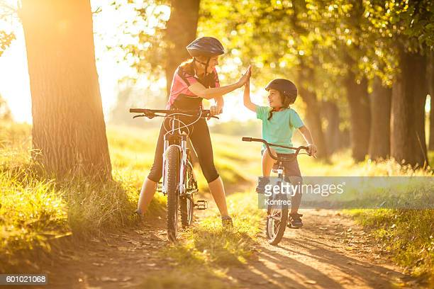 Mother and son cycling in the countryside