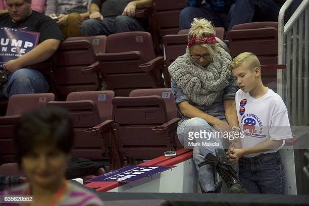 Mother and son Danica Weaber with Mason pray before a rally with Republican Presidential nominee Donald J Trump at Giant Center November 4 2016 in...