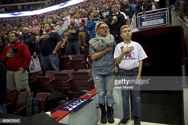 Mother and son Danica Weaber with Mason say the pledge of allegiance during a rally with Republican Presidential nominee Donald J Trump at Giant...