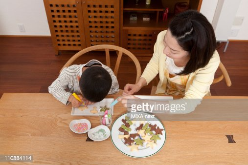 Mother and Son Decorating Cookie : Stock Photo