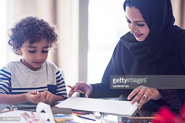 Mother and son drawing at home
