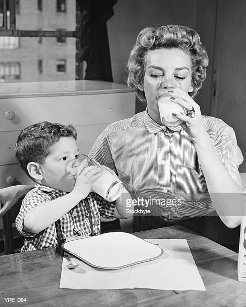 Mother and son drinking milk