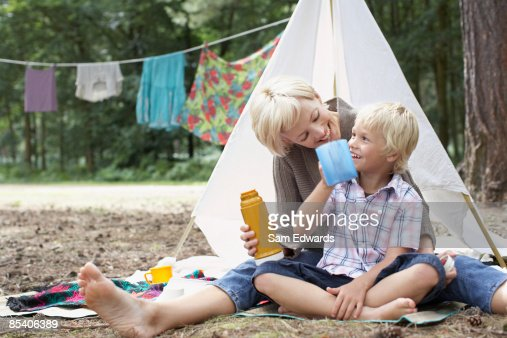 Mother and son enjoying campsite : Stock Photo