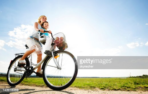Mother and son enjoying in a bicycle ride. : Stock Photo