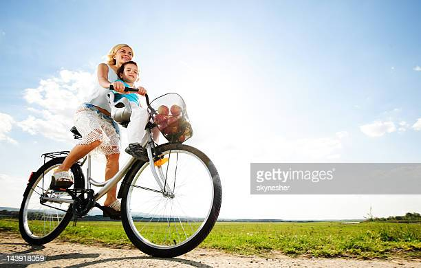 Mother and son enjoying in a bicycle ride.