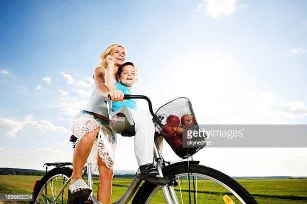 Mother and son enjoying in a bicycle ride
