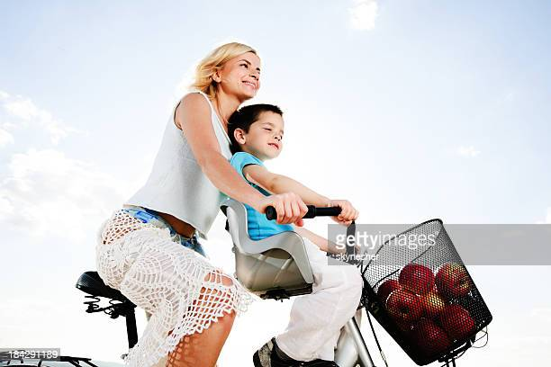 Mother and son enjoying in the bicycle ride