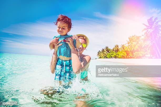 Mother and son enjoying in the sea