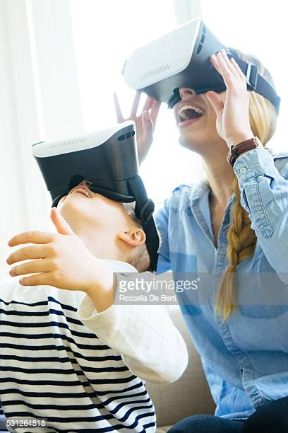 Mother and Son Experiencing Virtual Reality, Having Fan At Home