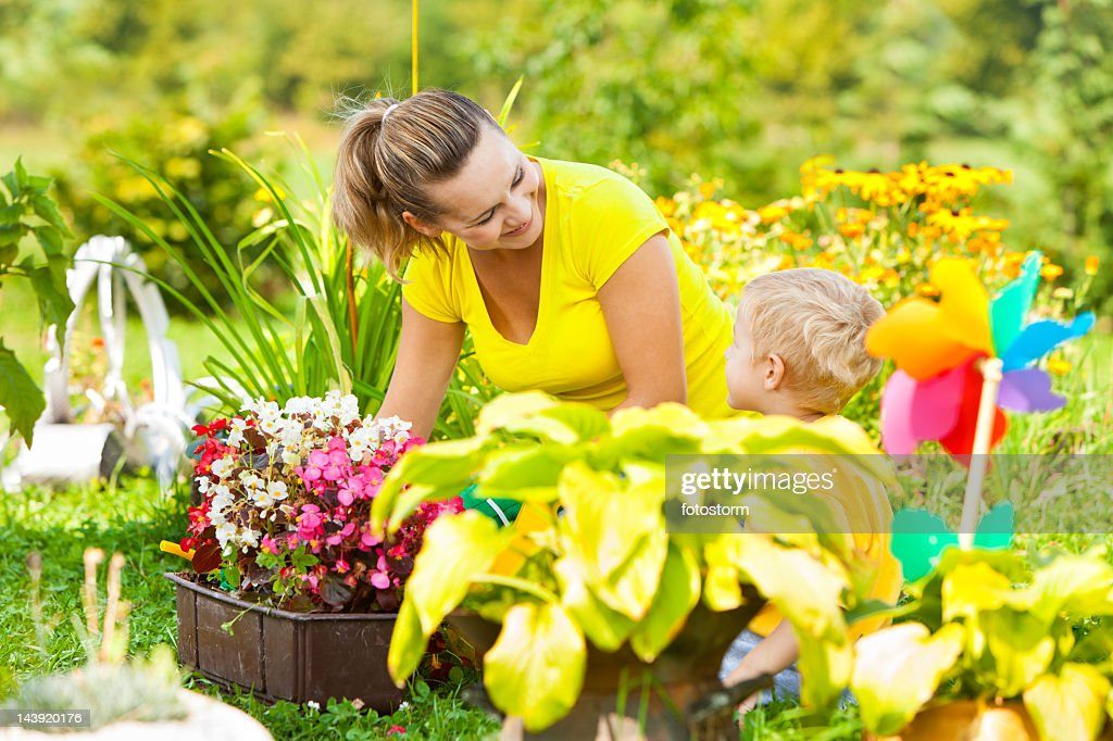 Mother And Son Gardening : Stock Photo