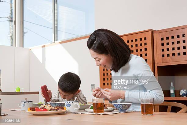 Mother and Son Having a Meal Together