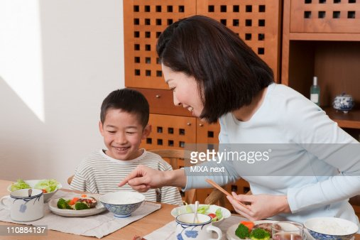 Mother and Son Having a Meal Together : Stock Photo