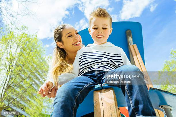 Mother and son having fun at the playground