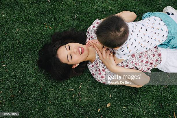 Mother and son having fun together in a park