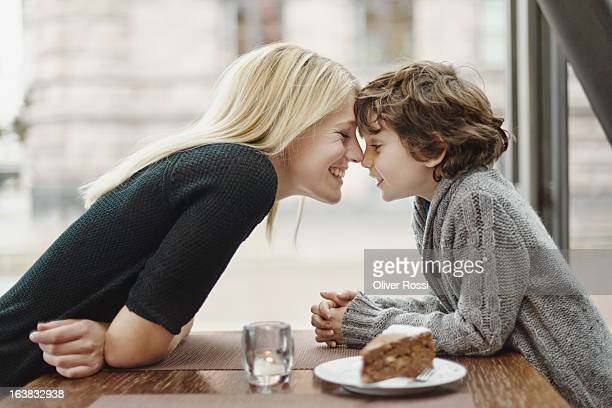 Mother and son head to head in a café