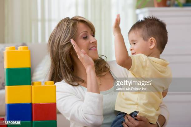 Mother and son high fiving