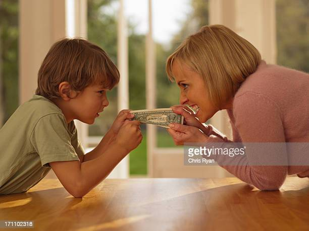 Mother and son hold paper currency
