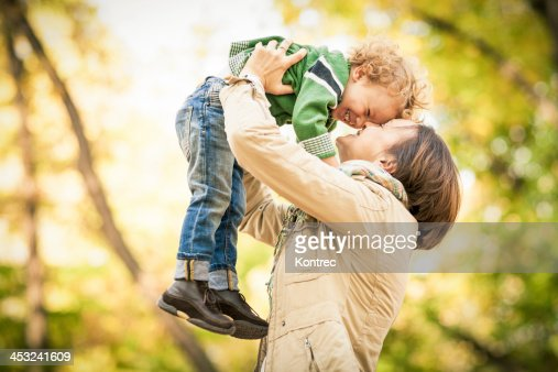 Mother and son holding each other joyfully : Stock Photo