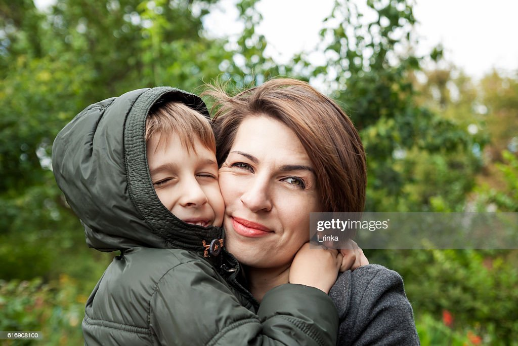 Mother and son hugging in park : Stock Photo