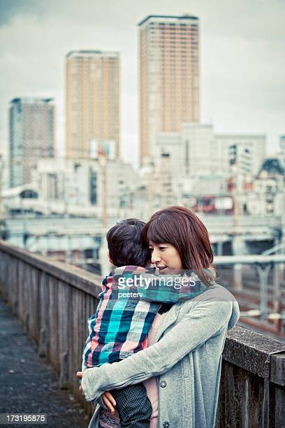 mother and son in big city