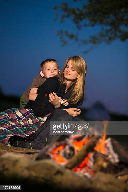 Mother and Son in front of campfire