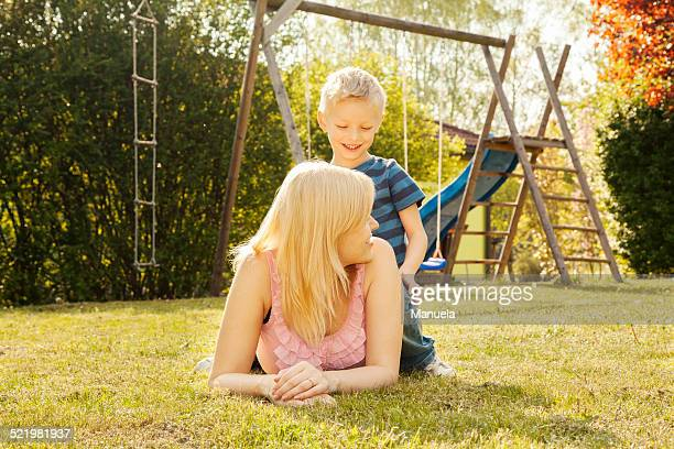 Mother and son in garden, swings in background