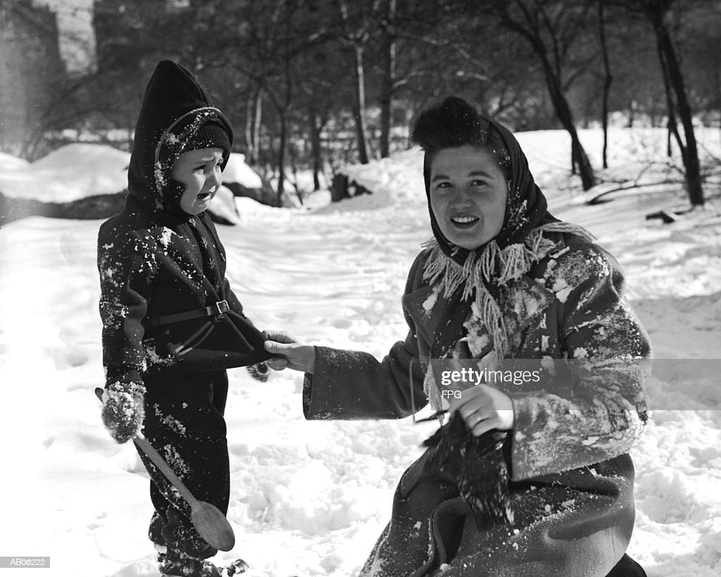 Mother and son (2-4) in snow in park, boy crying (B&W) : Stock Photo