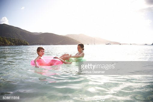 Mother and son in water on inner tubes : Stock Photo