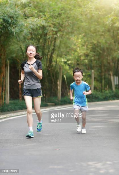mother and son jogging outdoors